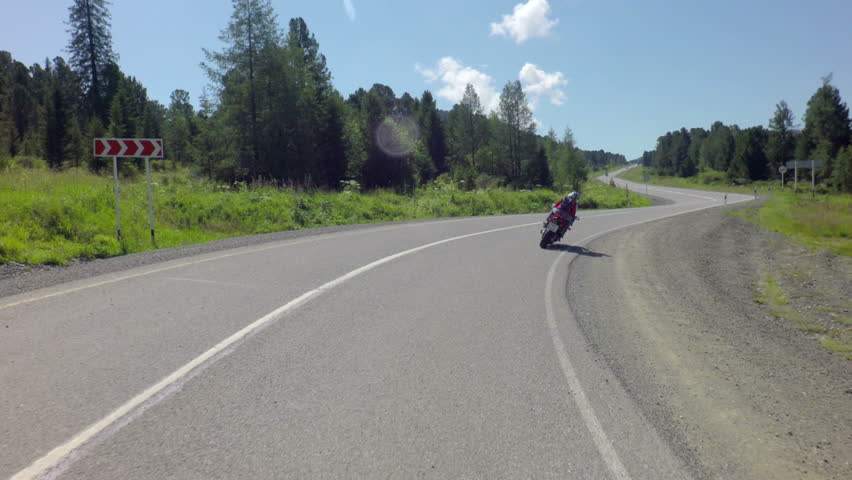 Altai Republic, Russia - July 14, 2015: Motorcycle moving on Chuysky Trakt  - HD stock video clip