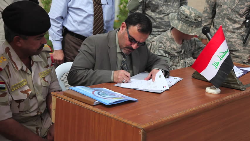 CIRCA 2010s - U.S. soldiers formally transfer security of various military locations to the Iraqi Army.
