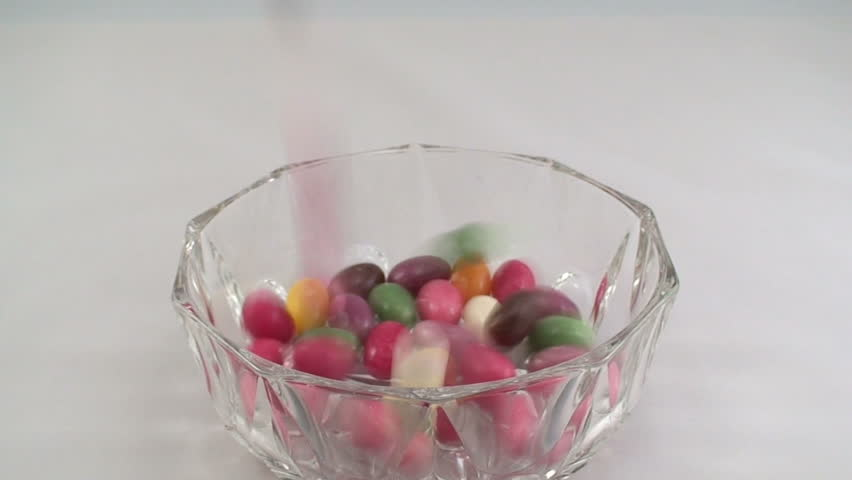 Pouring candies into the bowl