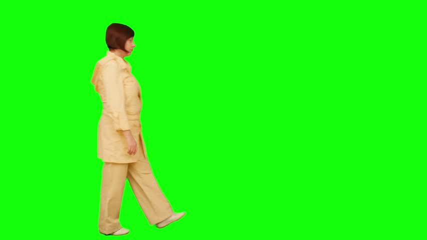 Woman goes from left to right. Green screen. No focus. - 4K stock footage clip