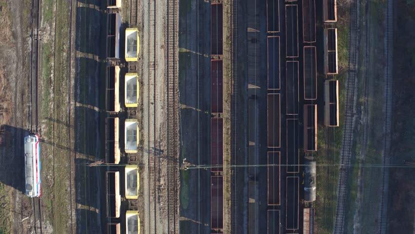 Flying over empty railway cars. Freight wagons and trains. Aerial video. Rail transportation. Many freight cars. Delivery of goods via trains. | Shutterstock HD Video #13400855