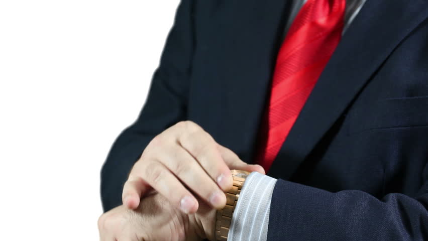Businessman in blue suit and red tie wearing a golden wrist watch checking time impatient over a white background. - HD stock footage clip