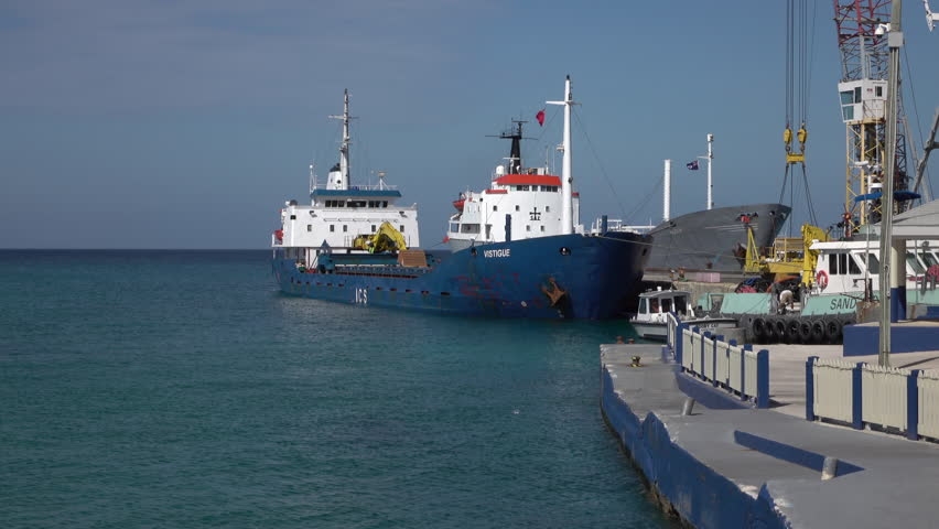 GRAND CAYMAN - NOV 2015: Grand Cayman Island in Caribbean required cargo and commercial ships and boat to supply almost all needs. Little natural resources are available. Tourist and banking center.