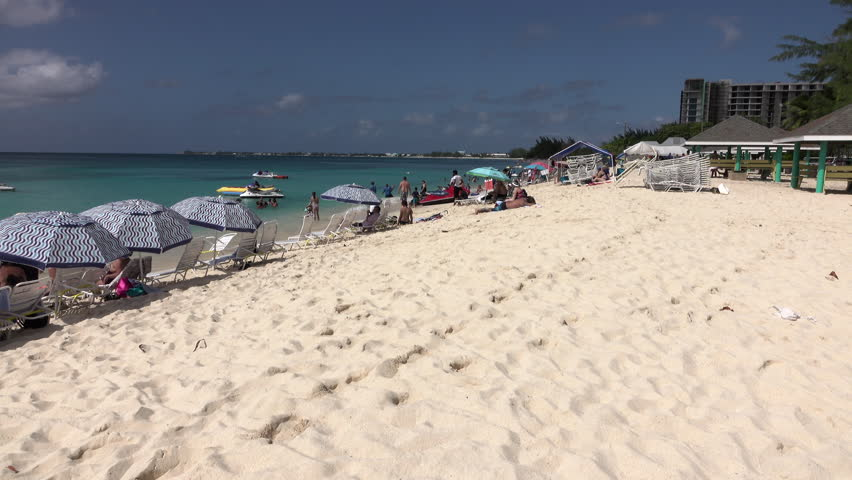 GRAND CAYMAN - NOV 2015: Grand Cayman Island Caribbean Ocean sandy beach pan. Tourism and off shore banking are main economic stimulus. Beach and resorts cater to tourists. Vacation destination.
