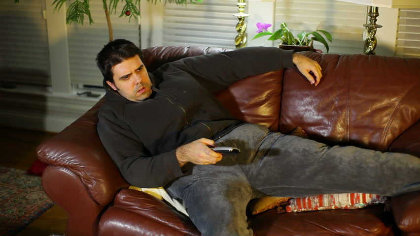 An obese guy watching TV - HD stock video clip