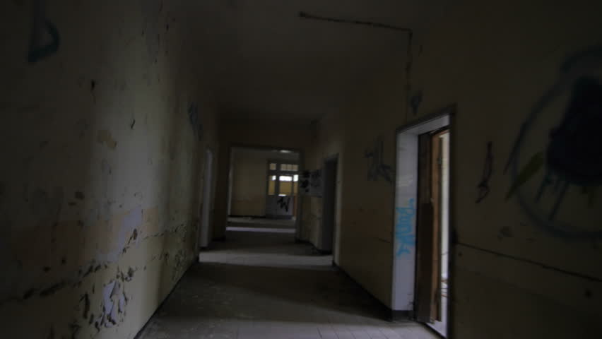 Horror movie scene of hallway abandoned building by camera dolly ...