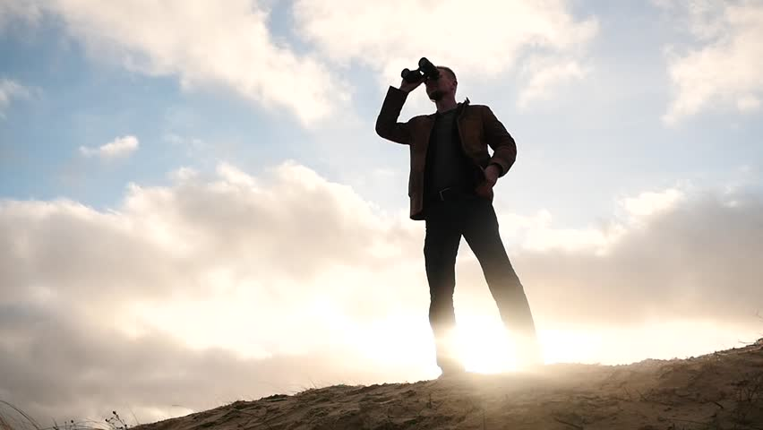 Man With Binoculars In Silhouette