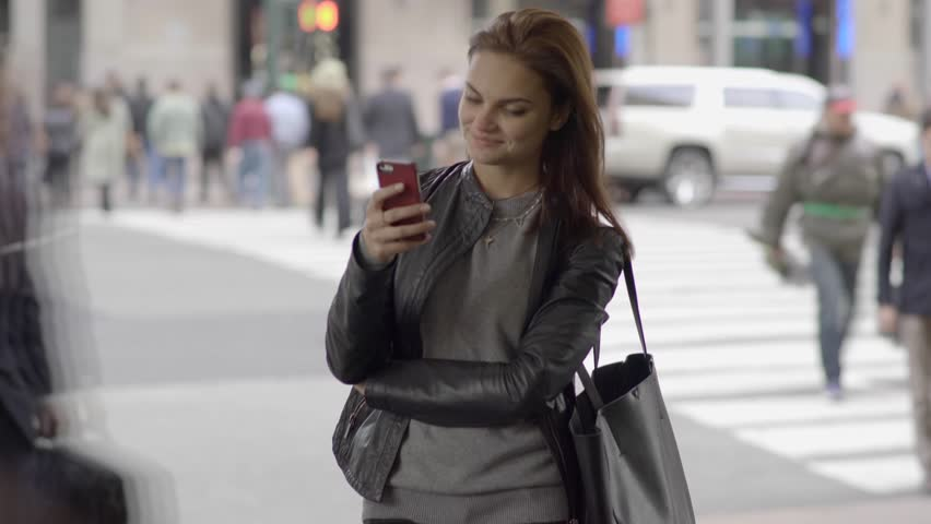 Attractive young business women using smart phone while commuting to work. city lifestyle portrait of successful female. commuters background  | Shutterstock HD Video #13530653