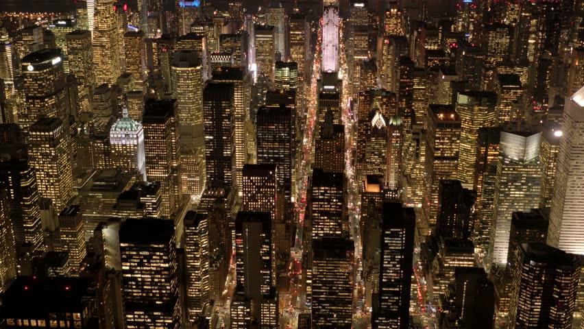 aerial view of new york city skyline buildings at night. urban metropolis background. establishment shot of nyc.