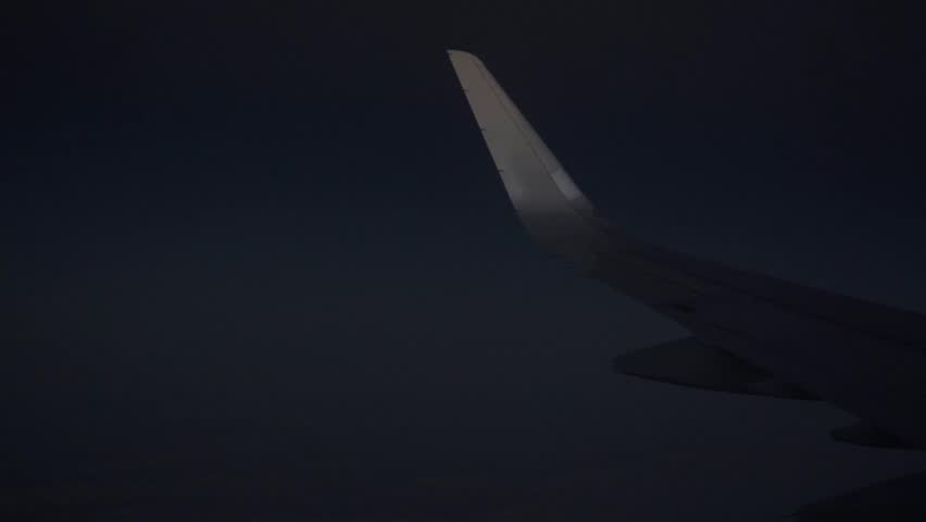 Passenger aircraft flying high at night. View from porthole - HD stock video clip