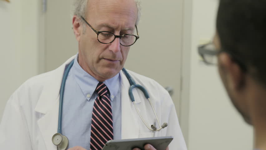 Doctor Consults patient using a tablet.  | Shutterstock HD Video #13551110