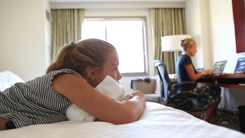 Mother and son in hotel room
