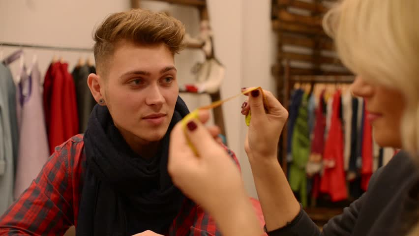 Fashion designer and seamstress cutter discuss new collection | Shutterstock HD Video #13594328