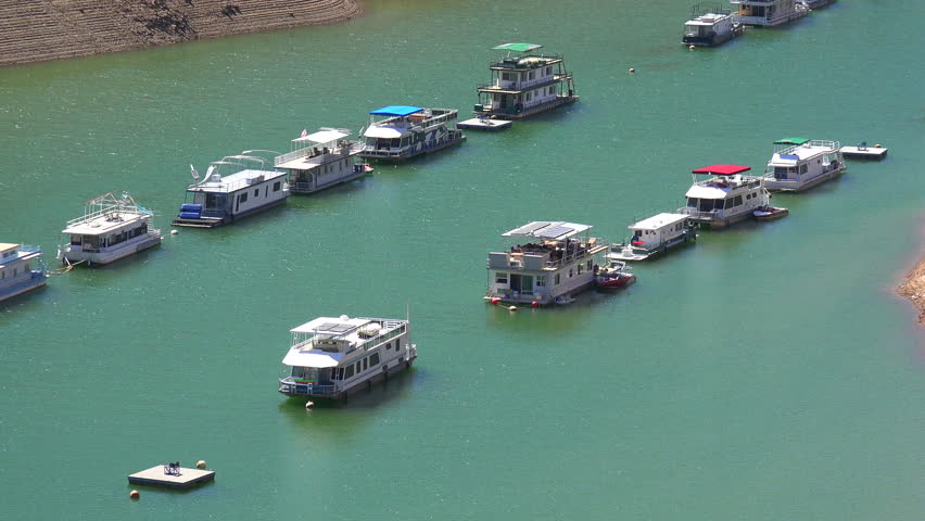 OROVILLE LAKE, CALIFORNIA - CIRCA 2015 - Houseboats sit low in the water at Oroville Lake in California during extreme drought. | Shutterstock HD Video #13596029
