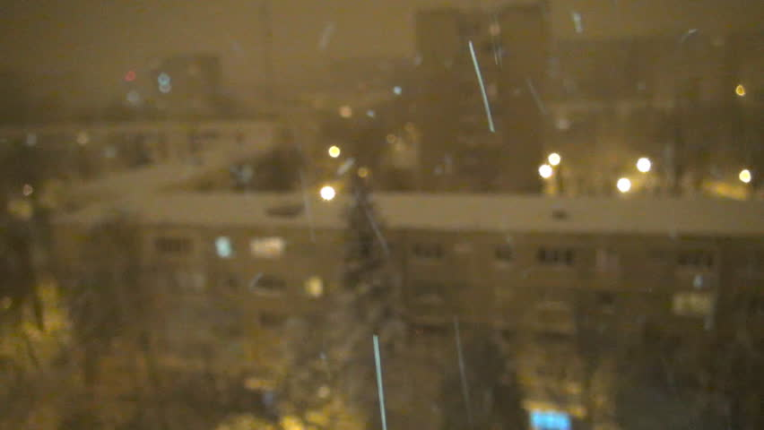 Snowing in Night, Aerial Snow Fall Christmas Scene, Winter View in Town District - HD stock footage clip