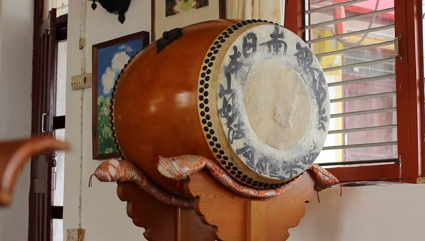 Buddhist drum. Buddhists bang into it when say mantras | Shutterstock HD Video #13626836