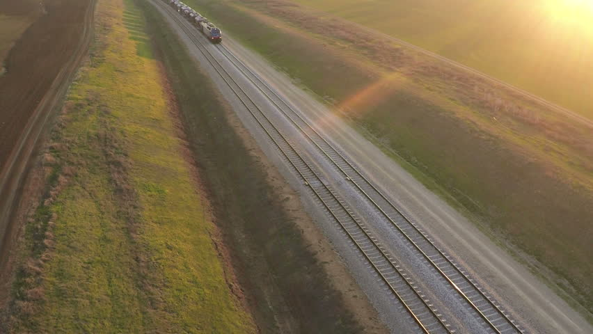 Aerial view of train at sunset - HD stock video clip