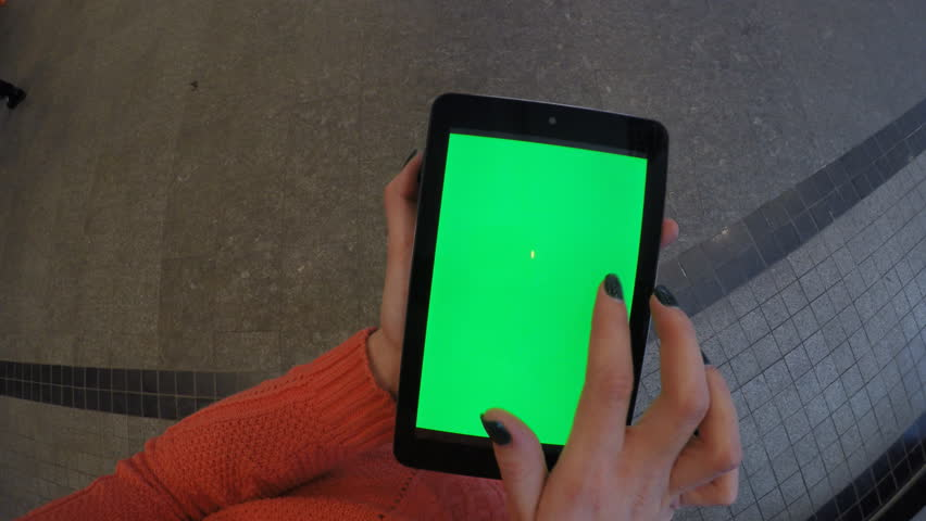Woman at shop using tablet with green screen | Shutterstock HD Video #13679081