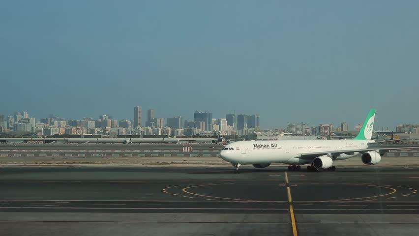 DUBAI, UNITED ARAB EMIRATES - DECEMBER 2015: Dubai International Airport. Airplane drives up to the ramp