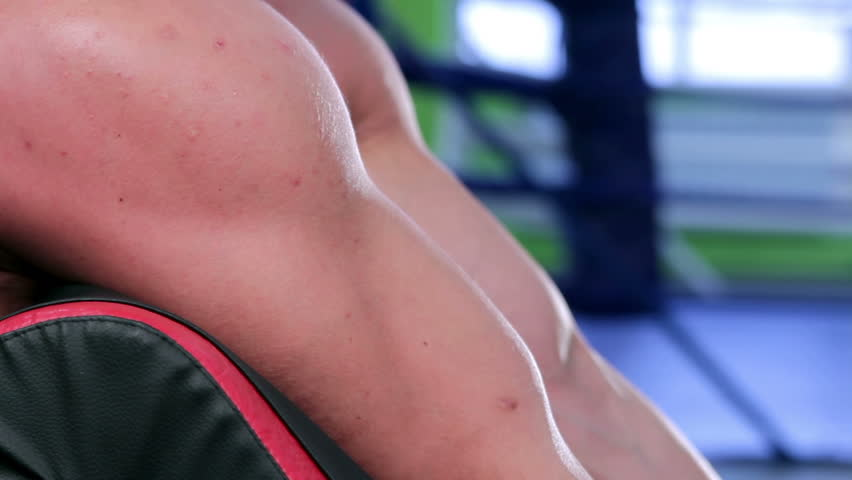 Workout for young bodybuilder. Man doing exercise for biceps with barbell closeup