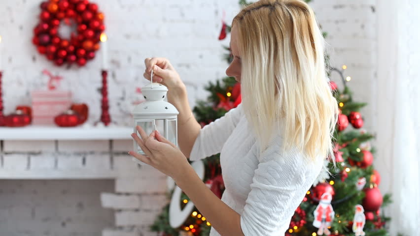Beautiful girl with a candle lantern is standing  - HD stock video clip