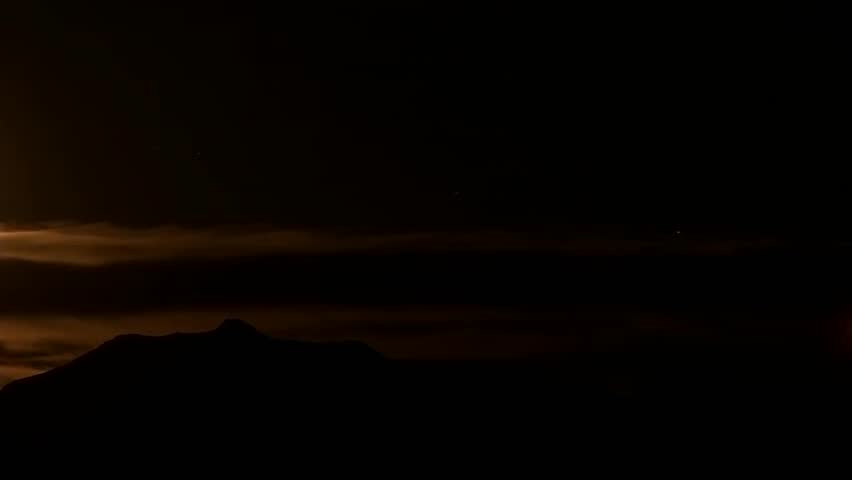 Moon passing over the mountains - HD stock footage clip