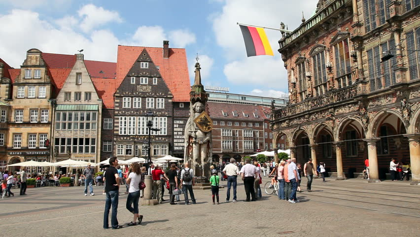 BREMEN, GERMANY - MAY 23: People enjoying a sunny day in the market square of Bremen on May 23, 2010. In the center is the Roland Statue, and on the right the  city hall, a UNESCO World Heritage Site. - HD stock footage clip