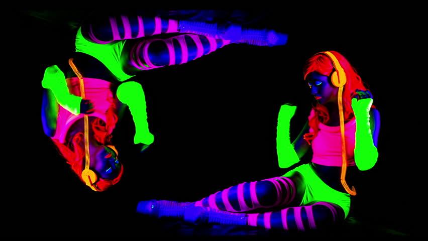 Fantastic video of sexy cyber raver dancer babe filmed in fluorescent clothing under UV black light | Shutterstock HD Video #13746194