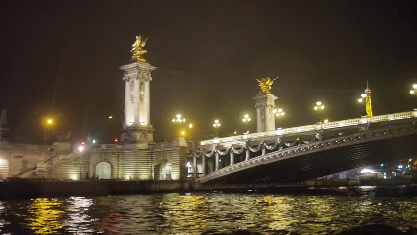 Paris, France - October, 2015 - Boat ride along the river Siene at night from Pont Alexandre III to the Tour Eiffel. - HD stock footage clip