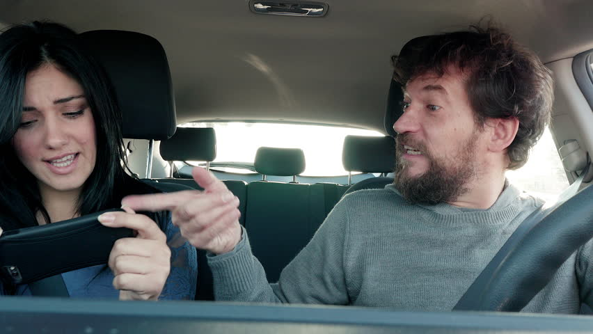 Woman trying to find road with maps on cell phone with digital navigator while man is driving 4K | Shutterstock HD Video #13781600