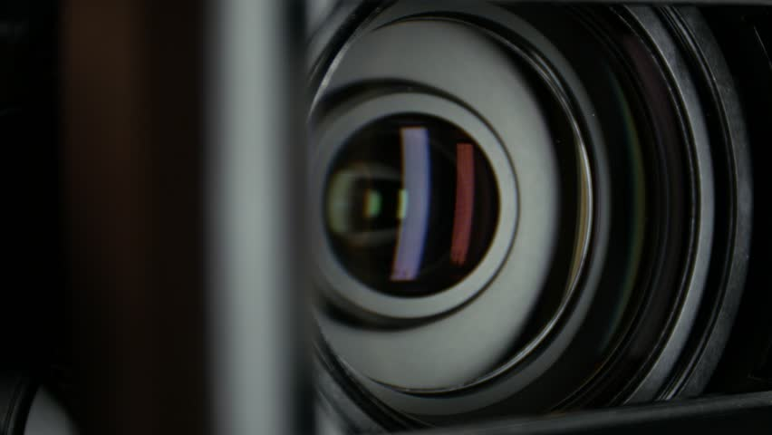 Video camera lens, showing zoom and glare, turns, close up