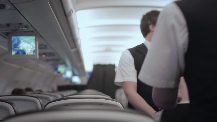 Flight attendants Cabin crew catering service - Full HD. Flight attendant, cabin crew, stewards, air hosts, are members of an aircrew employed by airlines primarily to ensure the safety and comfort
