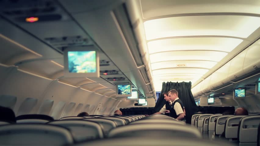 Cabin crew catering service aboard - Full HD. LONDON, ENGLAND - 06 DECEMBER 2015; Flight attendant are members of an aircrew employed by airlines to ensure the safety and comfort of passengers.   Shutterstock HD Video #13861970