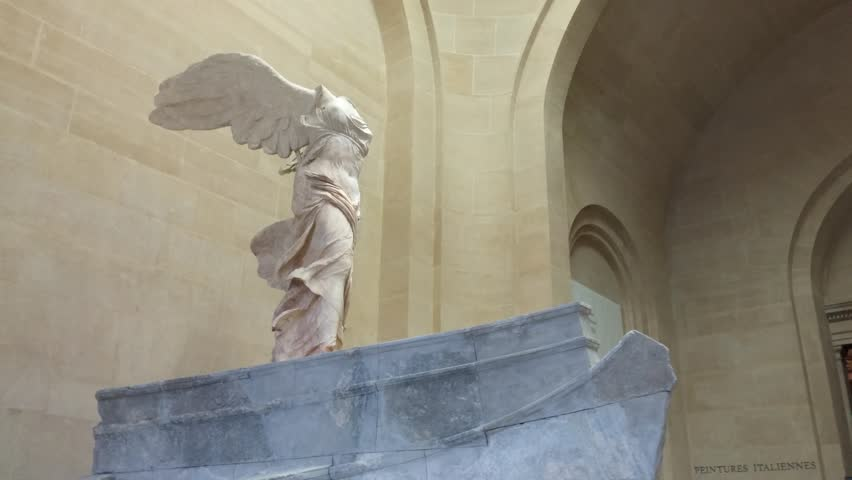 Paris, France - October, 2015 - Side shot of the Winged Victory of Samothrace statue in the Musée Louvre.