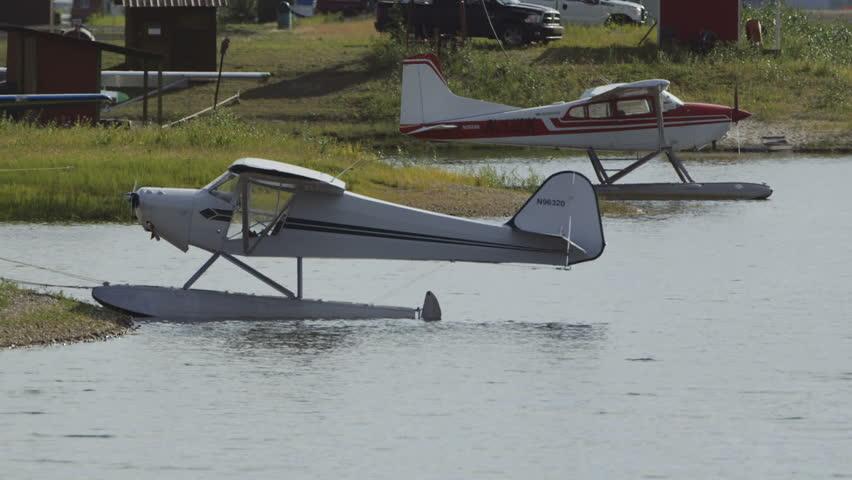 Fairbanks, Alaska, USA - JULY 2015. Float Planes Parking On The Lake  In Fairbanks International Airport. Canon C300. - HD stock footage clip