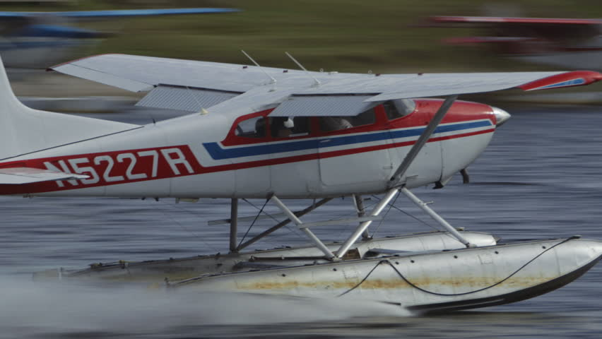 Fairbanks, Alaska, USA - JULY 2015. Float Plane Takes Off In Fairbanks International Airport. Canon C300. - HD stock footage clip