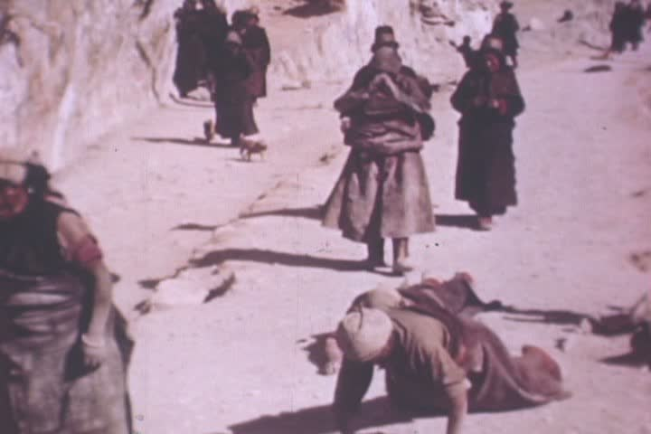 CIRCA 1940s - Shots of the Potola and the child Dalai Lama sits on a throne in Tibet in the 1940s. - SD stock footage clip
