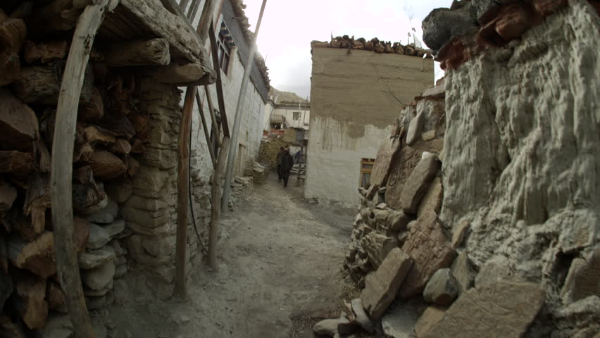 MS POV Shot of Kagbeni's streets with houses and people walking / Kabana, Mustang, Nepal - HD stock footage clip