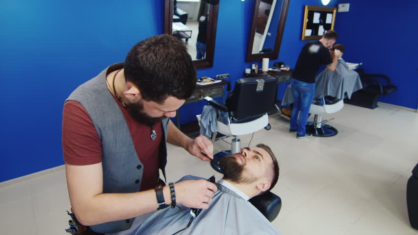 barber shave the beard of the client with trimmer stock footage video 8819857 shutterstock. Black Bedroom Furniture Sets. Home Design Ideas