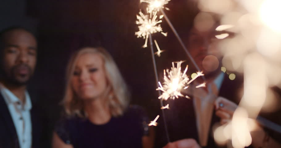 Sexy happy group of friends at glamorous party lighting sparklers having fun smiling celebrating new year's eve. | Shutterstock HD Video #14075972