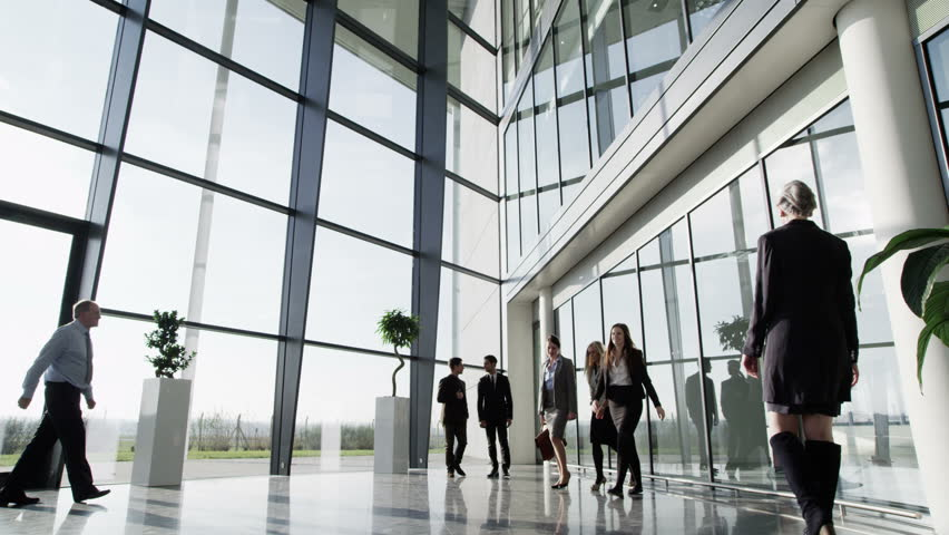 4k / Ultra HD version Three businessmen meet and shake hands in a busy modern office building on a bright day. In slow motion. Shot on RED Epic - 4K stock footage clip