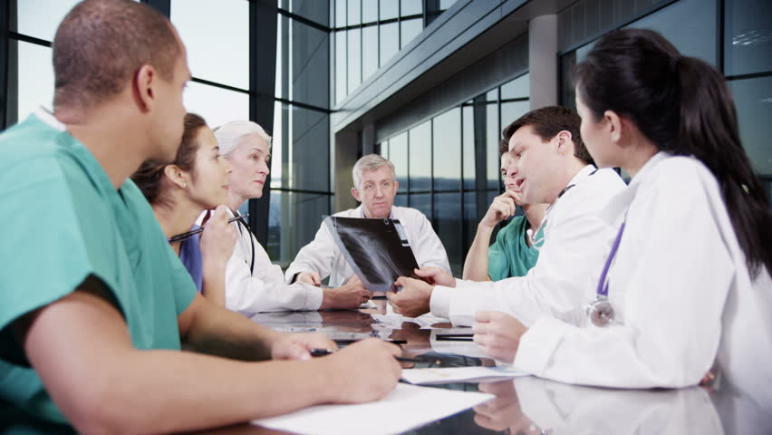 4k / Ultra HD version A diverse team of medical personnel are having a meeting in a light, modern private healthcare facility. They are discussing x-rays and looking for a diagnosis. In slow motion.  | Shutterstock HD Video #14127461