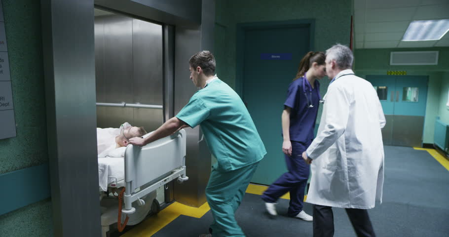 4k / Ultra HD version Hospital emergency team rush a patient on a gurney to the operating theatre. Shot on RED Epic | Shutterstock HD Video #14147774