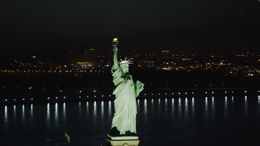 Aerial view of statue of liberty new york city at night for Iconic new york landmarks