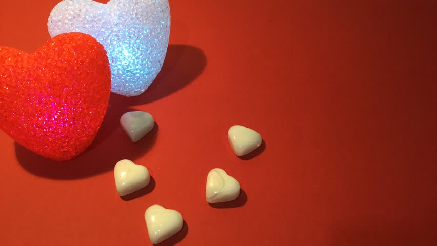 White and red hearts with colorful candles. - HD stock video clip