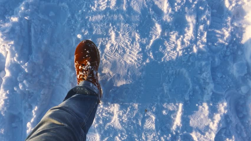 Feet of  man go on snow  winter, Slow motion | Shutterstock HD Video #14174819