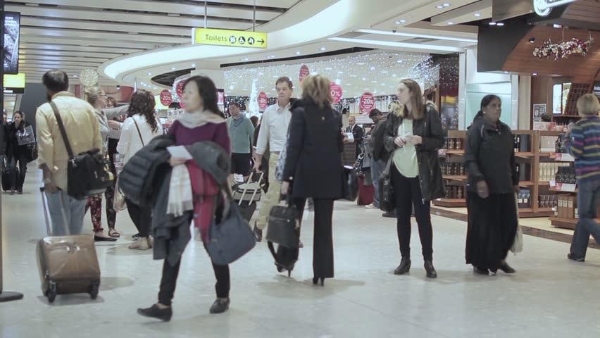 LONDON, ENGLAND - 06 DECEMBER 2015: Airport crowd international travelers rush. Crowd walking at the Heathrow airport, England - 1080p