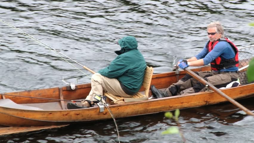 SOGNDAL, NORWAY  JUNE 26, 2013: Unidentified people do fishing from a boat in Sogndal, Norway. - HD stock footage clip