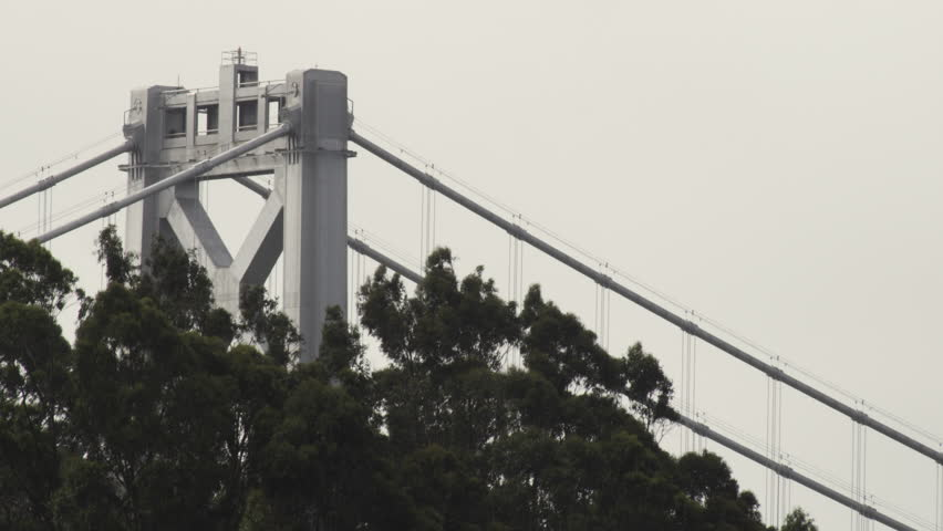 San Francisco, California CIRCA April 2010 - Tight static shot of the top support structure of the Oakland Bay Bridge and some treetops. | Shutterstock HD Video #14249924