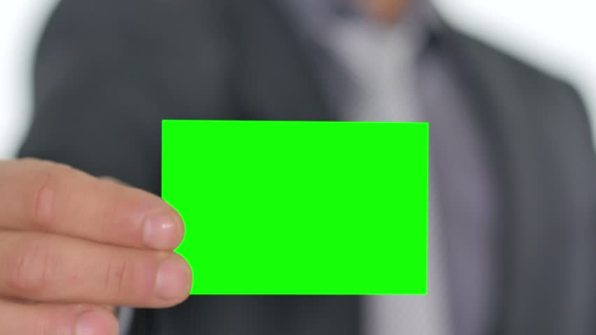 male hand giving a green business card to the camera pre keyed